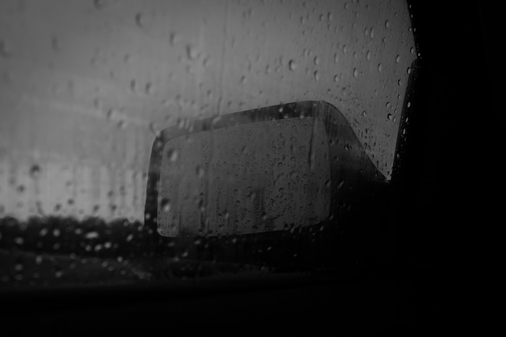 Raindrops on the window - car left rear mirror