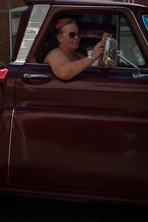 Woman sitting in the front of a car